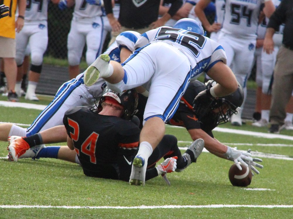 ROSS MARTIN/Citizen photo Platte County junior safety Hunter Tongate reaches out and grabs a fumble Friday, Sept. 9 in the first half against Harrisonville at Pirate Stadium.