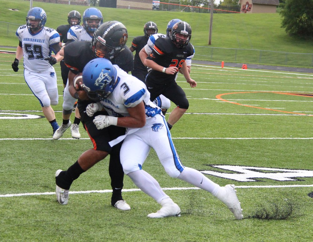 ROSS MARTIN/Citizen photo Harrisonville running back Morgan Selemaea (3) tries to tackle Platte County junior safety Kobe Cummings on a punt return in the first quarter Friday, Sept. 9 at Pirate Stadium. Cummings returned the kick 53 yards, and Selemaea injured his shoulder on the play.