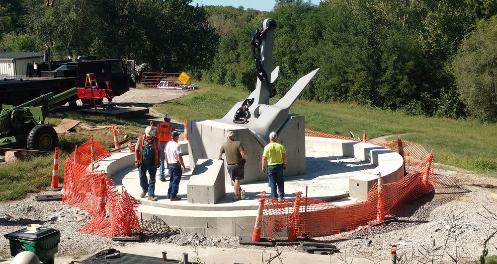 Contributed photo Workers recently set the anchor from the USS Platte into concrete for the monument at Settler's Crossing Park in Platte City.