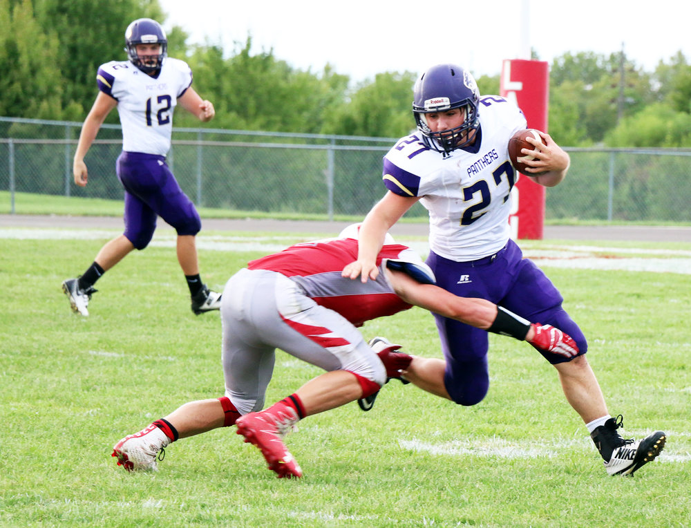 LeANN WILSON/Special to The Citizen North Platte senior running back Remington Wilson (27) tries to break a tackle against Lawson on Friday, Sept. 9 in Lawson, Mo.