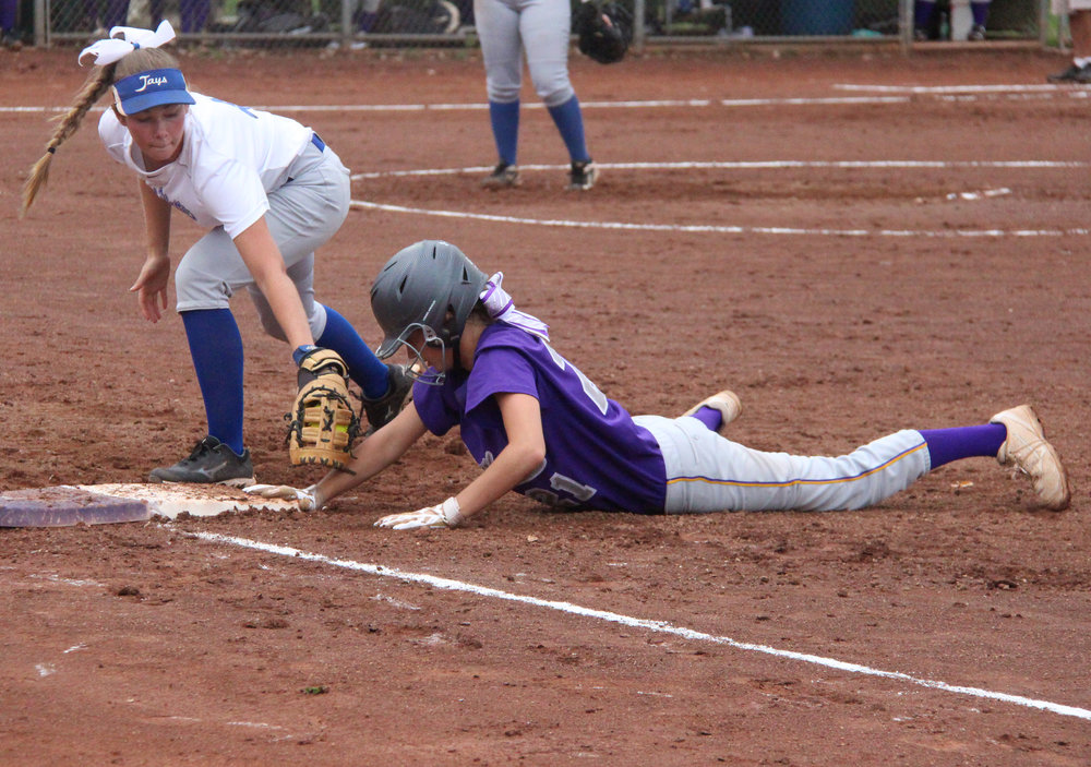 ROSS MARTIN/Citizen photo North Platte's McKenzie Sams, right, slides safely back into first as West Platte first baseman Rachel Heili applies a tag in a game Thursday, Sept. 8 at Dean Park in Dearborn, Mo.