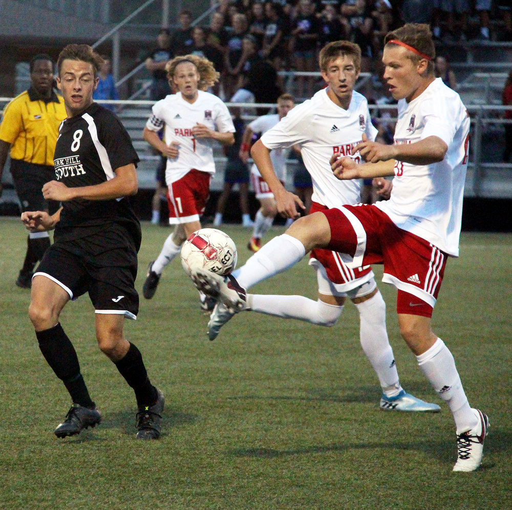 ROSS MARTIN/Citizen photo Park Hill senior defender Jackson Foutch, right, hits a clearance in front of Park Hill South forward Tyler Pisoni on Thursday, Sept. 8 at Park Hill District Soccer Complex in Riverside, Mo.