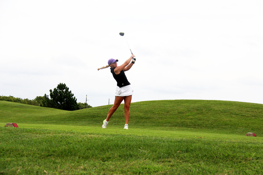 ROSS MARTIN/Citizen photo Park Hill South senior Miranda Steczak watches her shot off the 10th tee during the Pirate Invitational on Wednesday, Sept. 7 at Shiloh Springs Golf Course. Steczak finished third.