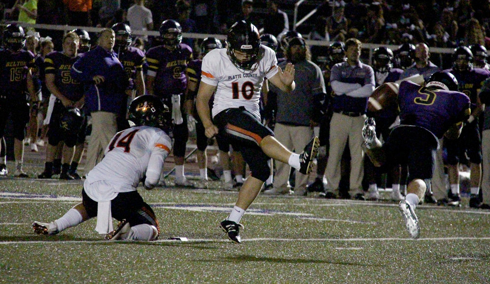ROSS MARTIN/Citizen photo Platte County kicker Parker Lacina (10) watches Belton's CJ Christensen (5) block a field goal attempt in the second quarter Friday, Sept. 16 at Southwick Stadium in Belton, Mo. Platte County senior Carter Nugent, left, was the holder on the play.