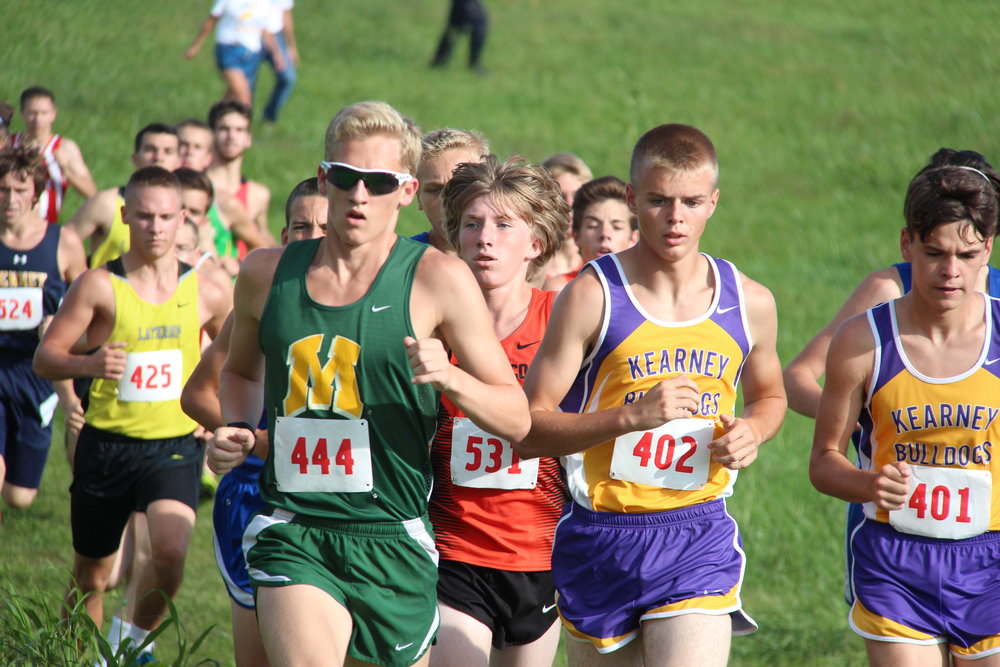 ROSS MARTIN/Citizen photo Platte County sophomore Jackson Letcher (531) runs in a pack down the first hill of the course at Platte Ridge Park during the Platte County Invitational on Thursday, Sept. 15.