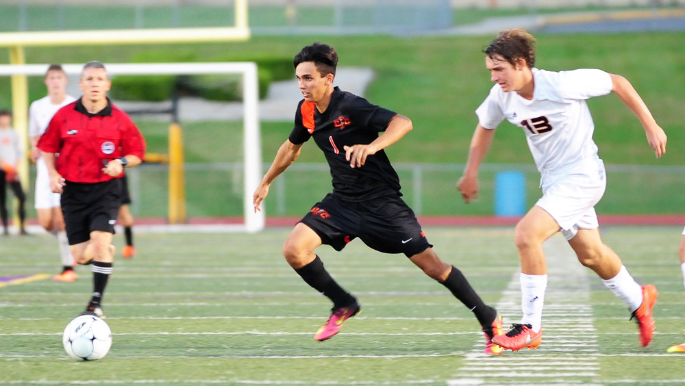 NICK INGRAM/Citizen photo Platte County junior midfielder Chandler Peterson (1) breaks away from a pair of Kearney defenders during a game Monday, Sept. 19 at Kearney High School in Kearney, Mo.