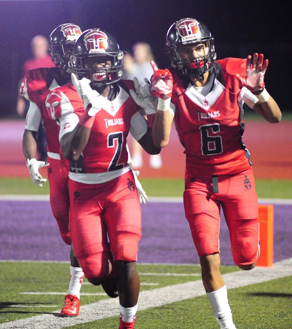 NICK INGRAM/Citizen photo Park Hill wide receiver DJ Johnson, left, and Ronnie Bell celebrate a second half touchdown against Lawrence Free State (Kan.) on Friday, Sept. 16 at Park Hill District Stadium in Kansas City, Mo.