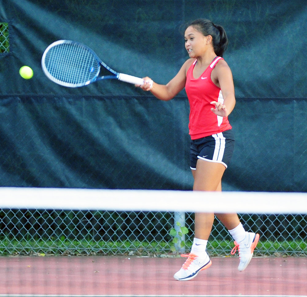 NICK INGRAM/Citizen photo Park Hill senior Camille Laude returns the ball against Park Hill South at the Thursday, Sept. 15 in a dual at Barry Park in Kansas City, Mo.