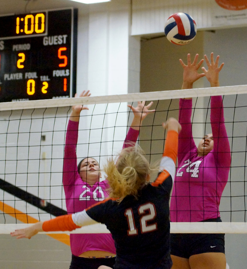 CHRIS PATTERSON/Citizen photo Park Hill sophomore Rachel Pella (20) and senior Tyah Barnett (24) go up to block an attack from Platte County's Bailey Harris during a pool play match in the Platte County Invitational on Saturday, Sept. 17 at Platte County High School.