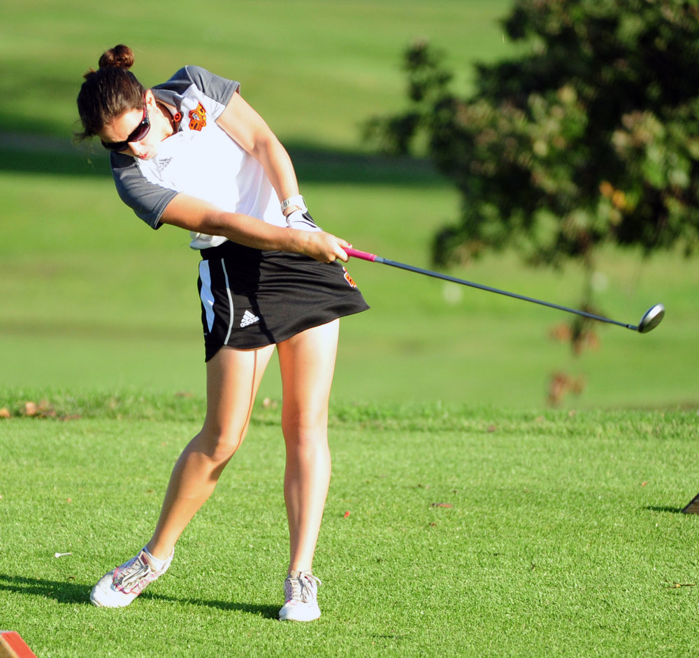 NICK INGRAM/Citizen photo Platte County sophomore Jessalyn Shipp watches a tee shot during the Suburban Conference Blue Division Championships held Tuesday, Sept. 20 at Shiloh Springs Golf Course.