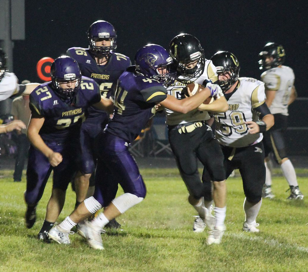 BREANNA L. CHEADLE/Special to The Citizen North Platte senior linebacker Parker Rotterman leads a gang tackle of a Lathrop runner during a KCI Conference game played Friday, Sept. 23 at North Platte High School in Dearborn, Mo.