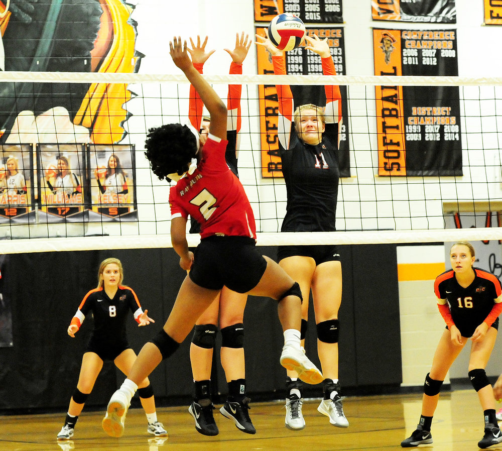 NICK INGRAM/Citizen photo Platte County junior Lauren Walker (11) goes for a block against Raytown South during a match Thursday, Sept. 22 at Platte County High School.