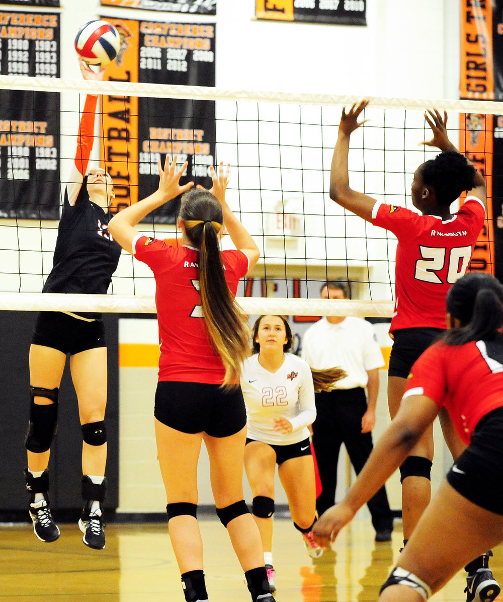 NICK INGRAM/Citizen photo Platte County senior Hannah Kunels, left, hits a spike against Raytown South on Thursday, Sept. 22 at Platte County High School.