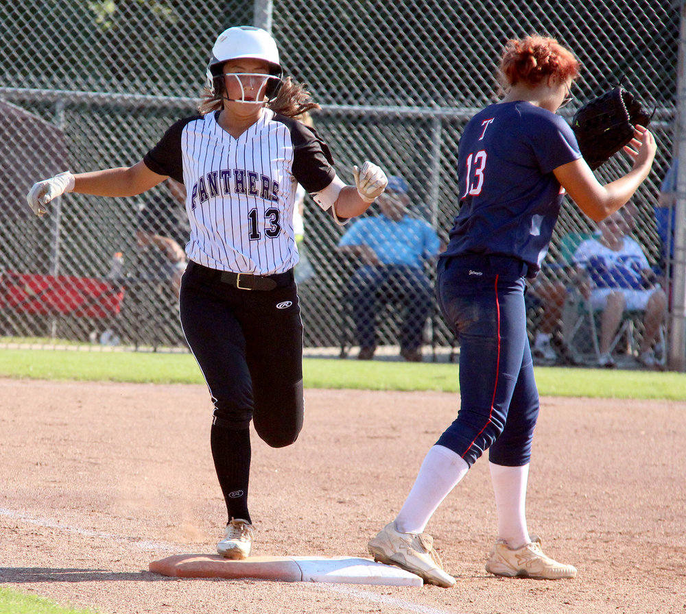 ROSS MARTIN/Citizen photo Park Hill South sophomore shortstop Kate Kobayashi, left, runs safely to first base Thursday, Sept. 22 in a game with Truman at Park Hill South High School in Riverside, Mo.