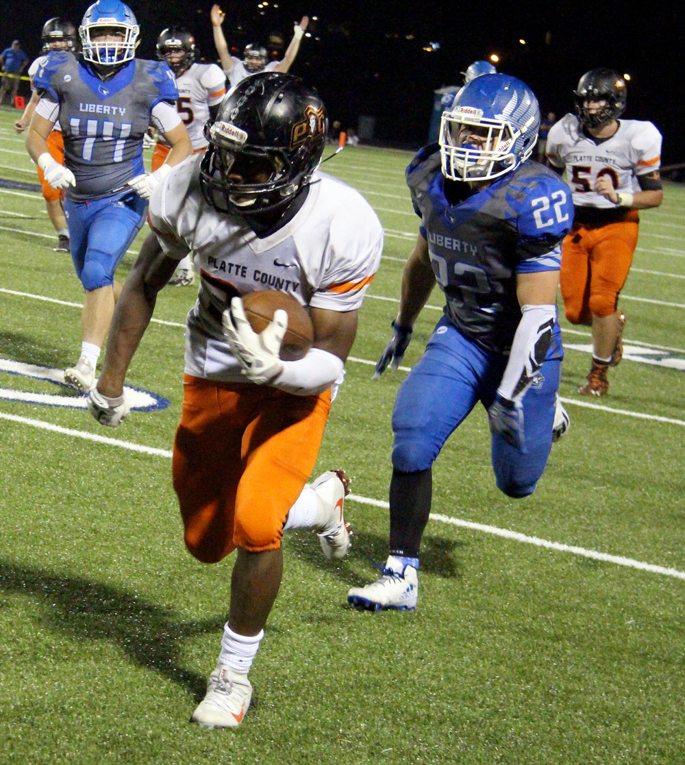 ROSS MARTIN/Citizen photo Platte County senior running back Mike McNair breaks into the open field on a long fourth quarter run Friday, Sept. 23 at Liberty High School in Liberty, Mo.