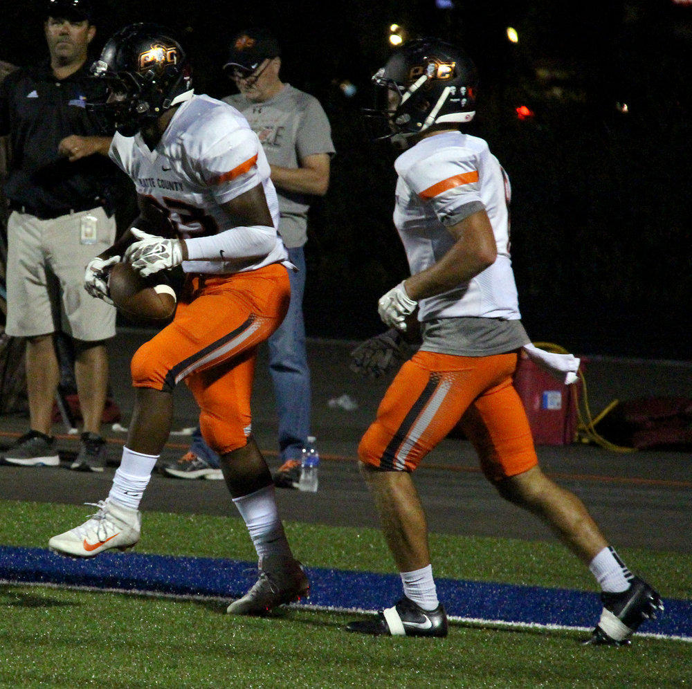 ROSS MARTIN/Citizen photo Platte County senior running back Mike McNair, left, celebrates a first half touchdown with senior wide receiver TJ Guillory on Friday, Sept. 23 at Liberty High School in Liberty, Mo.