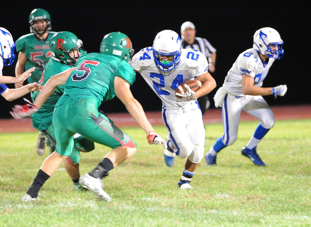 NICK INGRAM/Citizen photo West Platte running back Brayan Rodriguez tries to elude a Mid-Buchanan tackler on Friday, Sept. 30 at Mid-Buchanan High School in Faucett, Mo. The Dragons defeated West Platte 45-29 in a KCI Conference matchup.