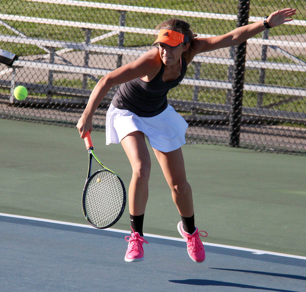 ROSS MARTIN/Citizen photo Platte County senior Rachel Valentine hits a backhand shot during a singles match in the Class 2 District 16 championship dual with Liberty on Wednesday, Sept. 28 at Clayview Country Club in Kansas City, Mo.