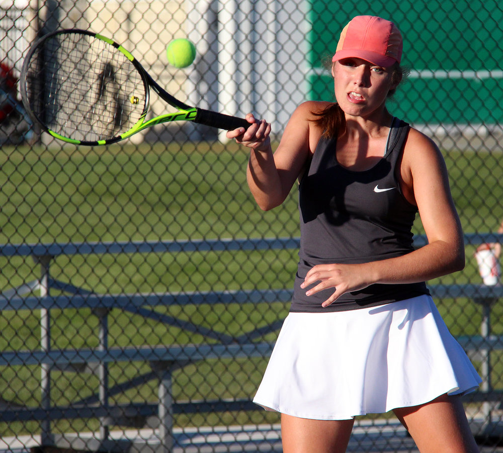 ROSS MARTIN/Citizen photo Platte County senior Madalyn Ivy hits a forehand shot during a singles match in the Class 2 District 16 championship dual with Liberty on Wednesday, Sept. 28 at Clayview Country Club in Kansas City, Mo.