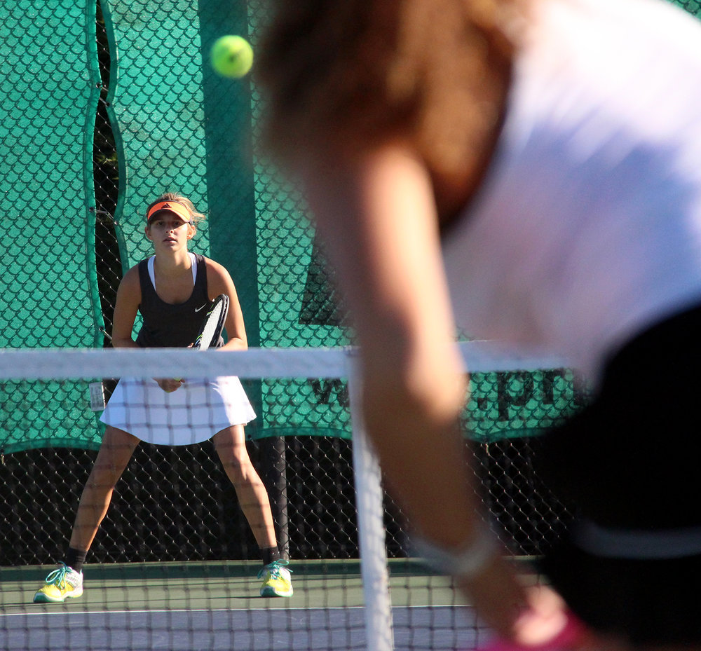 ROSS MARTIN/Citizen photo Platte County sophomore Hannah Valentine, left, awaits a serve from her opponent in the Class 2 District 16 championship dual with Liberty.