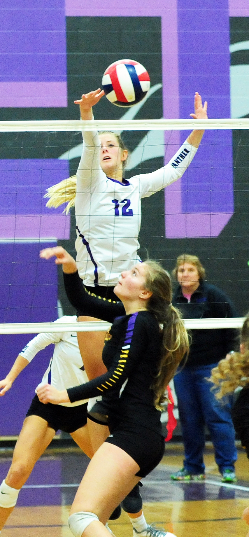 NICK INGRAM/Citizen photo Park Hill South senior Andi Elley (12) tips a ball over the net in a match with Blue Springs on Thursday, Sept. 29 at Park Hill South High School in Riverside, Mo.
