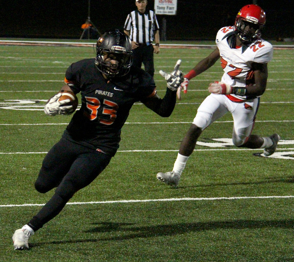 ROSS MARTIN/Citizen photos Platte County senior running back Mike McNair, center, runs away from a Raytown South defender Friday, Sept. 30 at Pirate Stadium.