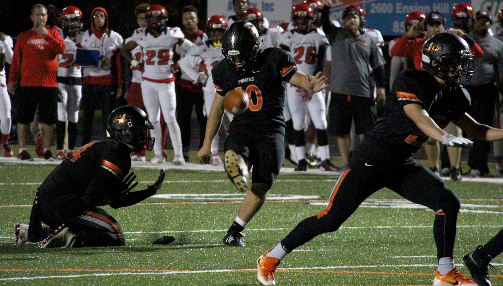 ROSS MARTIN/Citizen photo Platte County kicker Parker Lacina hits a field goal in the first half against Raytown South on Friday, Sept. 30 at Pirate Stadium.