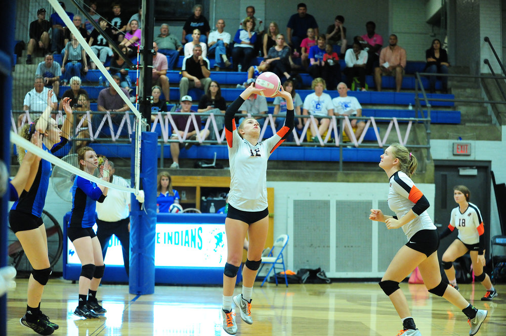 NICK INGRAM/Citizen photo Platte County senior Bailey Harris (12) hits a set for teammate Lauren Walker, right) during a nonconference matchup with St. Joseph Central on Thursday, Oct. 6 at Central High School in St. Joseph, Mo.