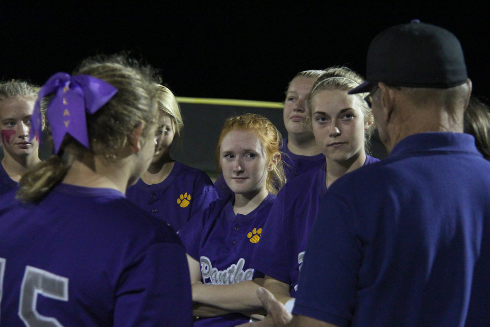 ROSS MARTIN/Citizen photo Kyra Patch (center), North Platte's lone senior listens to coach Ron Resler following a Class 2 District 14 loss to Mid-Buchanan on Wednesday, Oct. 5 at Lathrop High School in Lathrop, Mo.
