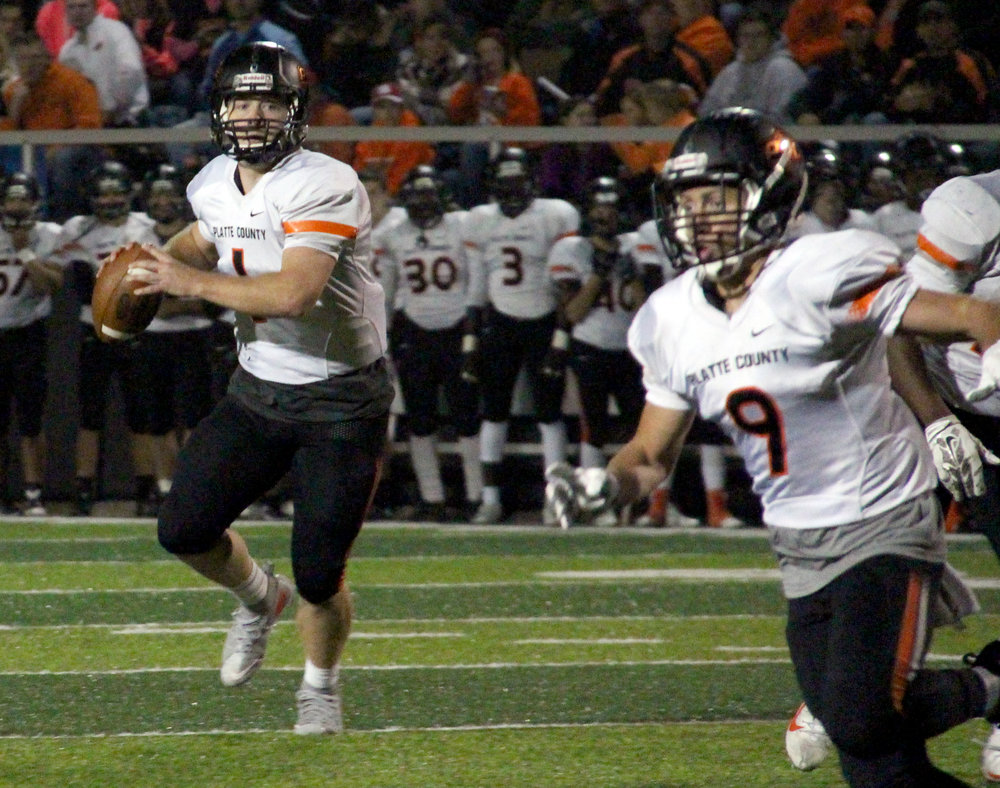 ROSS MARTIN/Citizen photo Platte County senior quarterback Justin Mitchell, left, prepares to throw a touchdown pass to senior wide receiver TJ Guillory on Friday, Oct. 7 against Winnetonka at North Kansas City District Stadium in North Kansas City, Mo.