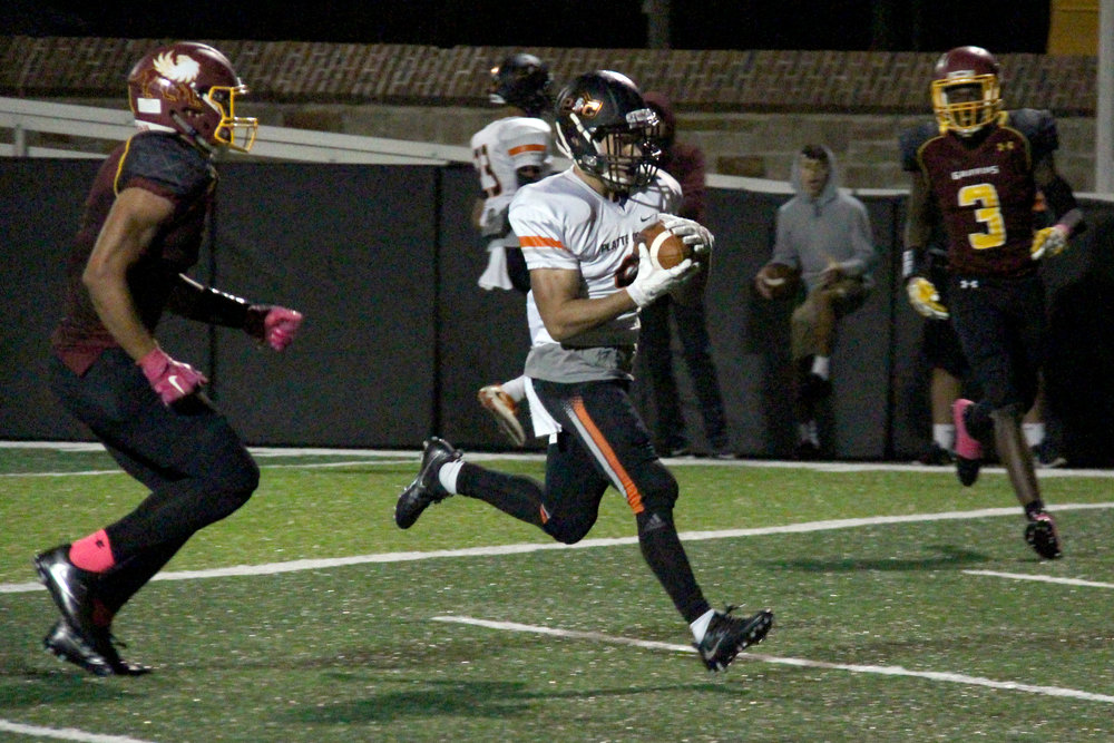 ROSS MARTIN/Citizen photo Platte County senior wide receiver TJ Guillory, center, skips into the end zone for one of his three first half touchdowns Friday, Oct. 7 against Winnetonka.