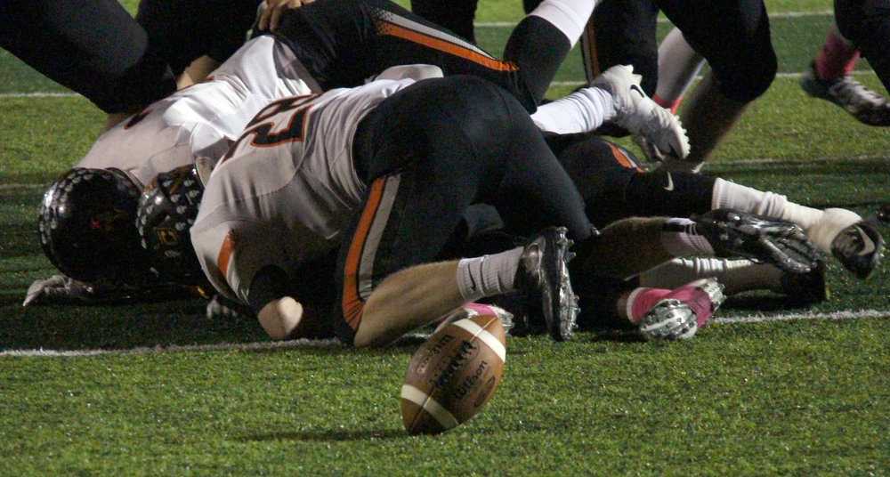 ROSS MARTIN/Citizen photo Platte County football players, including junior Dakota Schmidt (28), pile on Winnetonka quarterback Ben Giebler after he fumbled during the first half Friday, Oct. 7 at North Kansas City District Stadium in North Kansas City, Mo. A few seconds went by before players attempted to corral the loose ball with Winnetonka eventually recovering in the end zone, resulting in a safety for Platte County, which won 44-6 to improve to 6-2 on the season.