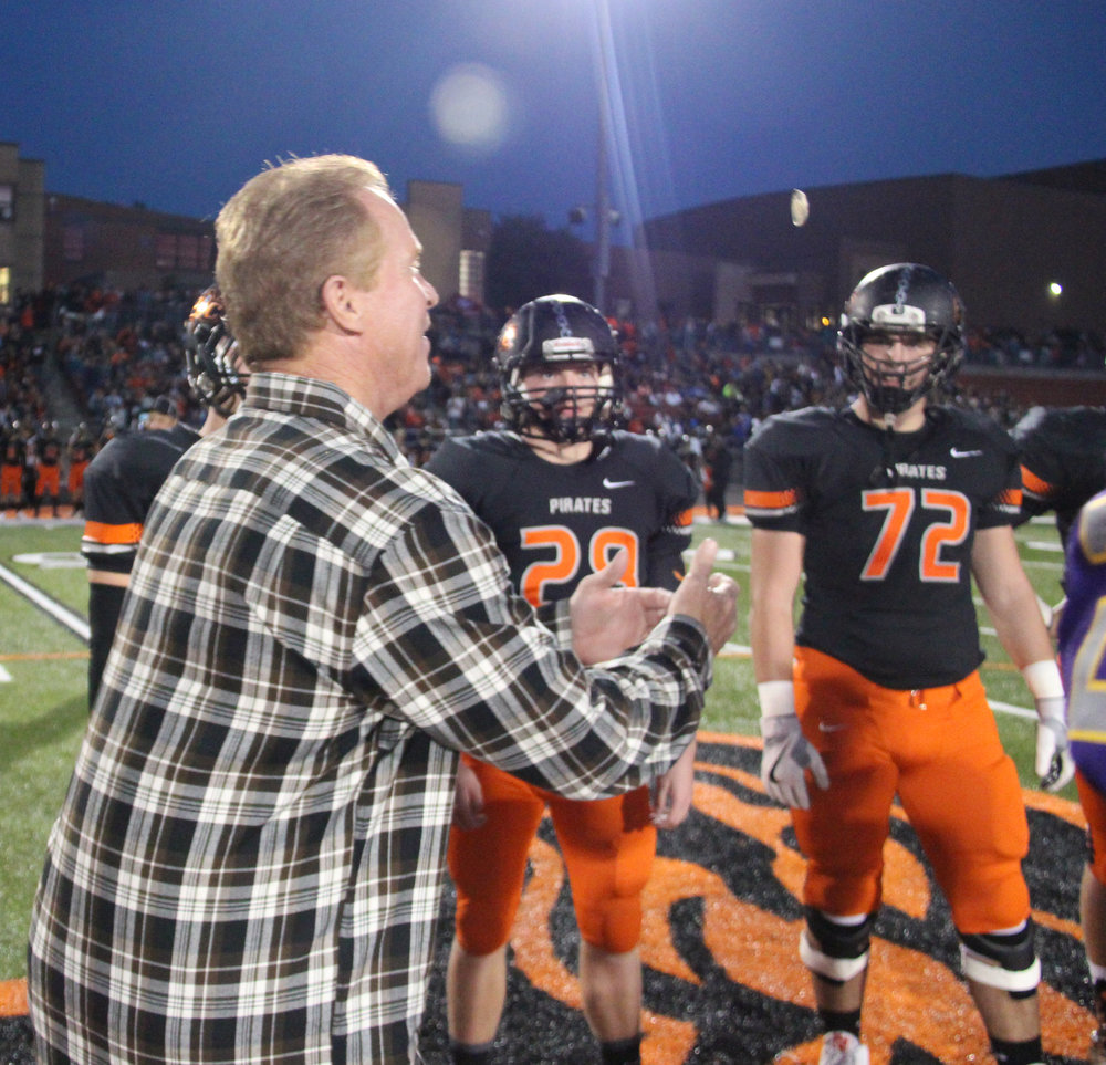 Contributed photo Kansas City Royals broadcaster Rex Hudler, left, served as honorary captain and flipped the coin for the football game between Kearney and Platte County on Friday, Oct. 14 at Pirate Stadium. The two rival schools helped raise money donated to Team Up for Down Syndrome — Hudler's charity that offers support to children with Down Syndrome or other special needs.