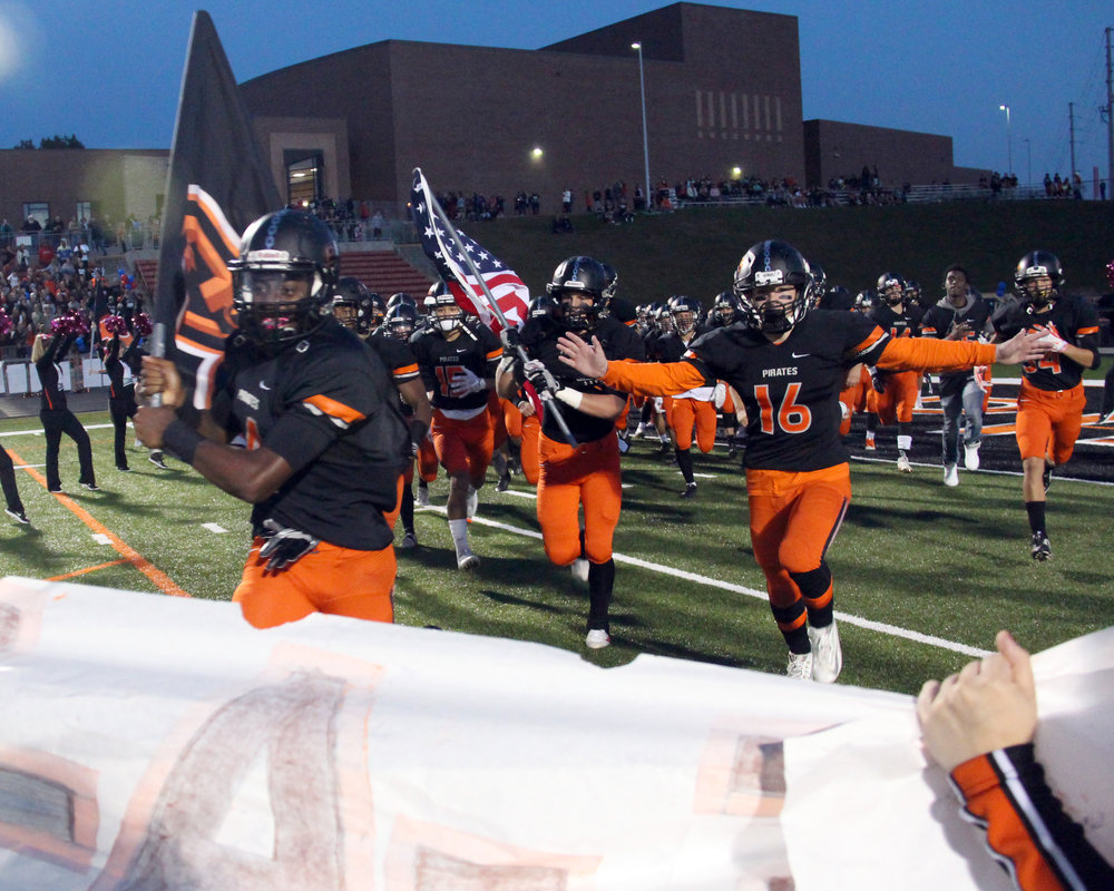 ROSS MARTIN/Citizen photo Platte County players enter the field prior to the game with Kearney on Friday, Oct. 14 at Pirate Stadium.