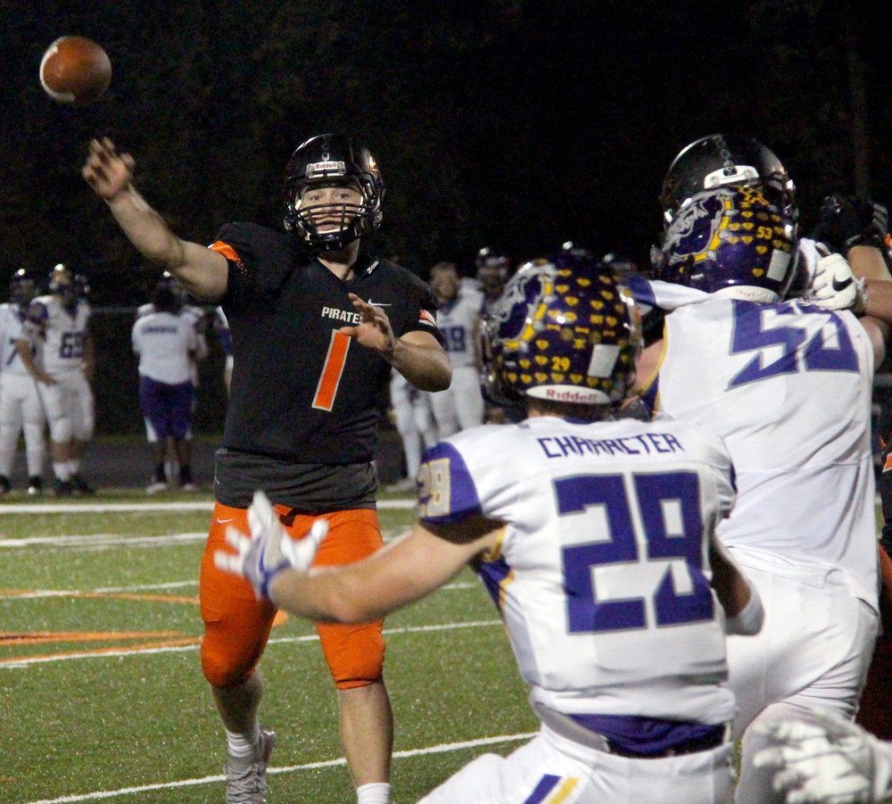 ROSS MARTIN/Citizen photo Platte County quarterback Justin Mitchell throws a pass against Kearney on Friday, Oct. 14 at Pirate Stadium. Mitchell eclipsed the 5,000-yard mark for passing yards in a career with 419 in the game to become the school's all-time leader.