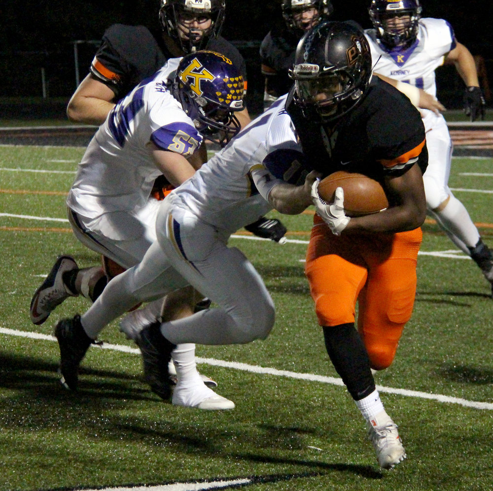 ROSS MARTIN/Citizen photo Platte County junior running back Mike McNair breaks a tackle. He finished with 90 yards rushing and moved into second in school history for career rushing yards (3,272).
