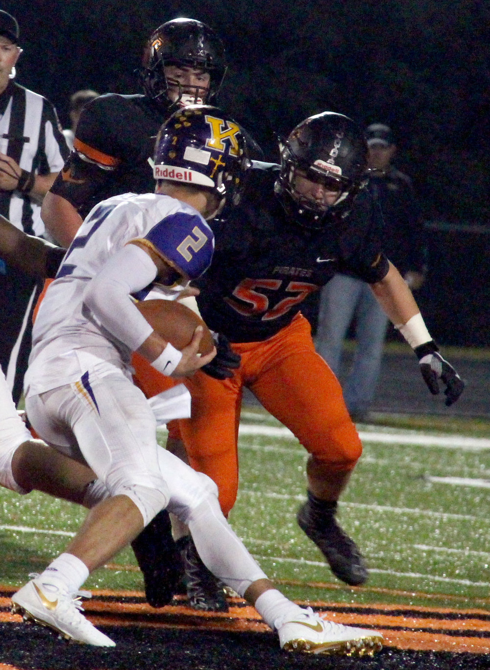 ROSS MARTIN/Citizen photo Platte County sophomore defensive linemen Peyton Stoner, right, and Glen Gammill, center, converge on Kearney quarterback Anthony Pritzel on Friday, Oct. 14 at Pirate Stadium.
