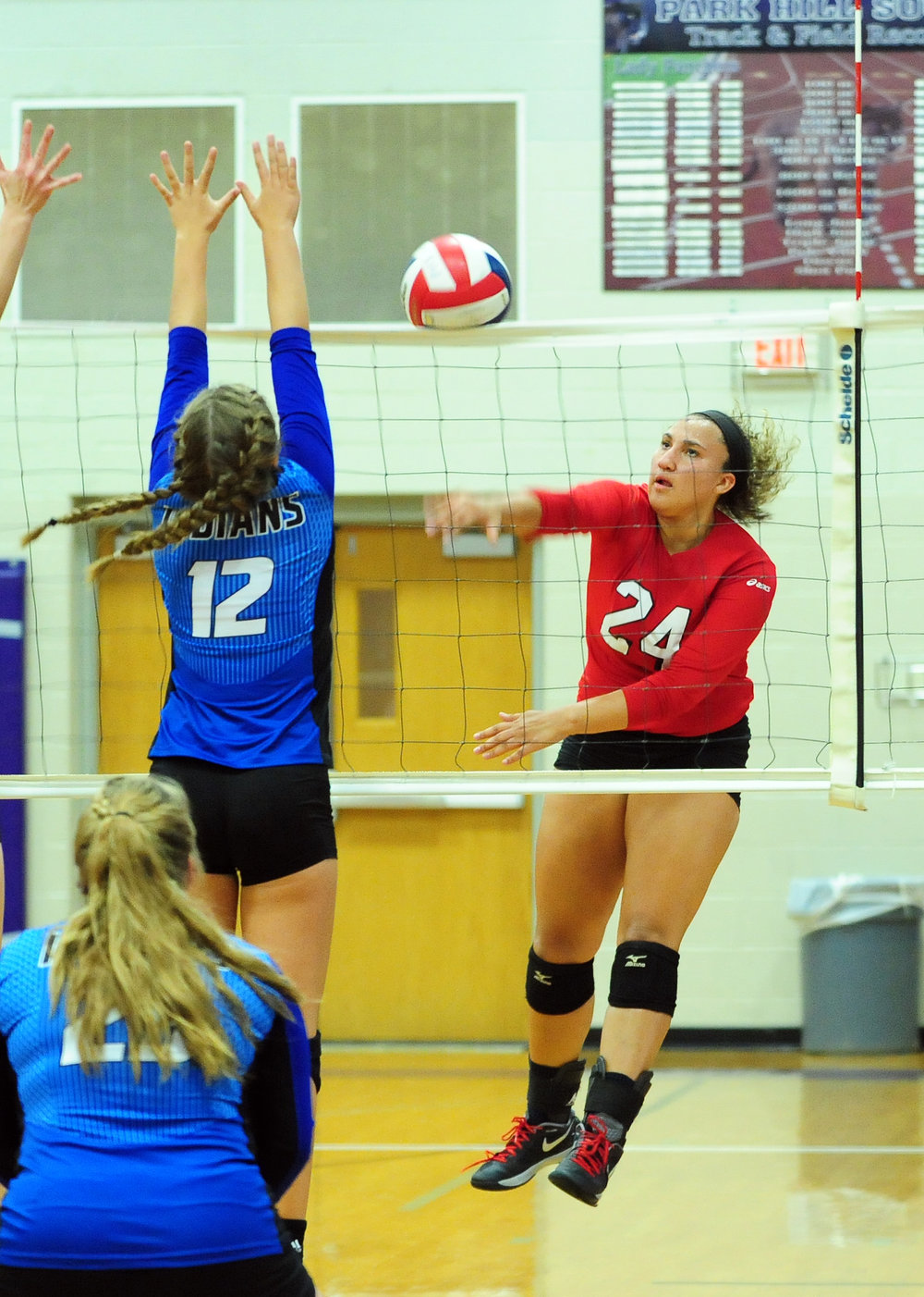 NICK INGRAM/Citizen photo Park Hill senior Tyah Barnett hits a spike during a Class 4 District 16 match with St. Joseph Central on Monday, Oct. 17 at Park Hill South High School in Riverside, Mo.