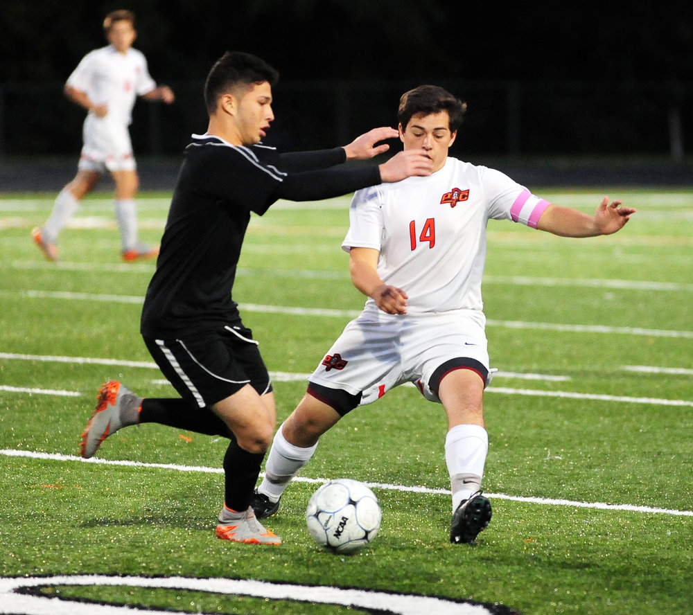 NICK INGRAM/Citizen photo Platte County senior Sam Stuteville (14) attempts to gain control of the ball from a Grandview player on Thursday, Oct. 13 at Pirate Stadium.