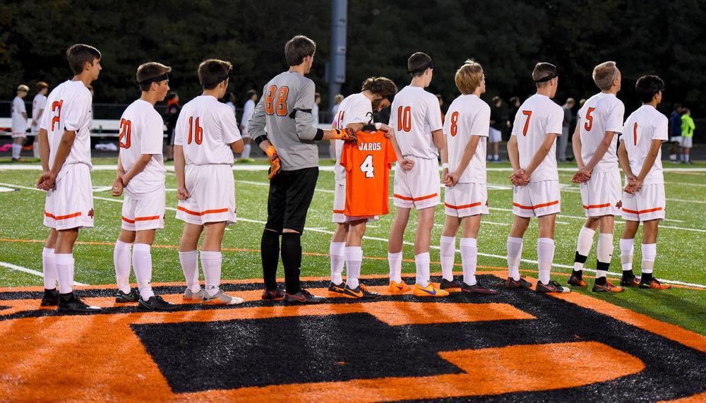 TODD NUGENT/Special to The Citizen Platte County's soccer team took the field with 10 men for the first four minutes of a match with Winnetonka on Thursday, Oct. 20 at Pirate Stadium. Prior to the game, the starters lined up for the national anthem with senior Zach Rolofson holding a special No. 4 jersey in memory of Landon Jaros, who died two days earlier due to complications with cancer. The 4-minute stretch at the start of the game were to honor the four years of Landon's life.
