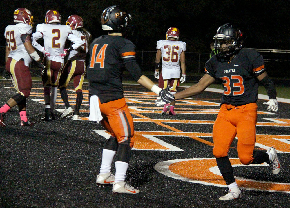 ROSS MARTIN/Citizen photo Platte County senior running back Mike McNair (33) celebrates one of his three touchdown with senior wide receiver Carter Nugent during the first half against Winnetonka on Friday, Oct. 21 at Pirate Stadium.