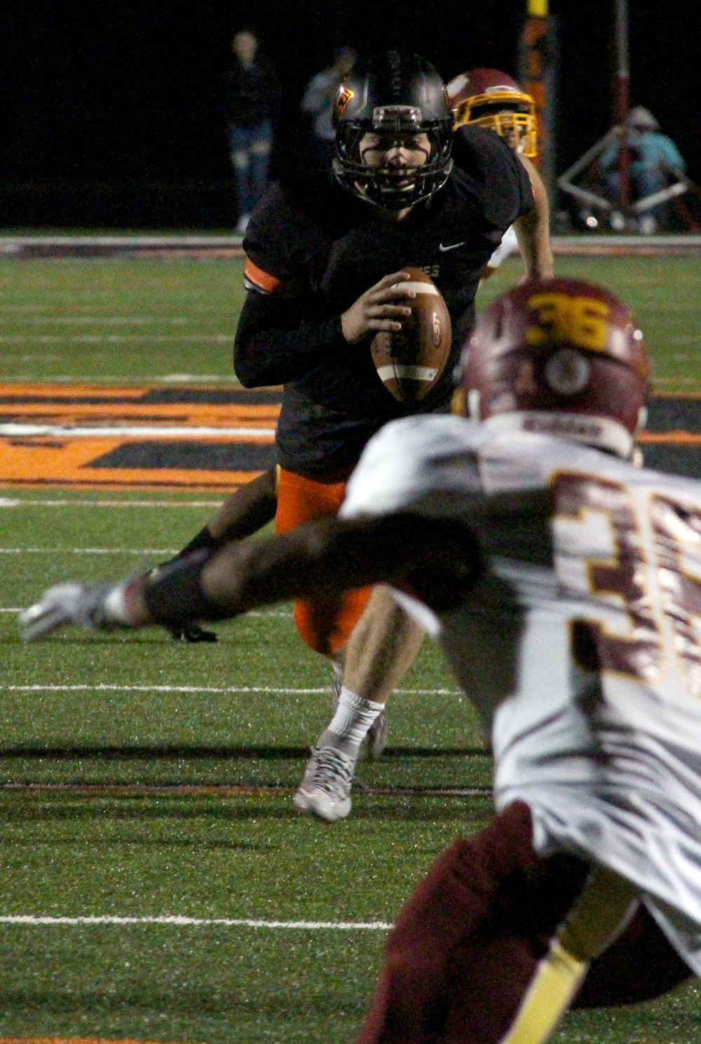 ROSS MARTIN/Citizen photos Platte County quarterback Justin Mitchell (1) scrambles toward the Winnetonka defense during a Class 4 District 8 matchup Friday, Oct. 21 at Pirate Stadium.