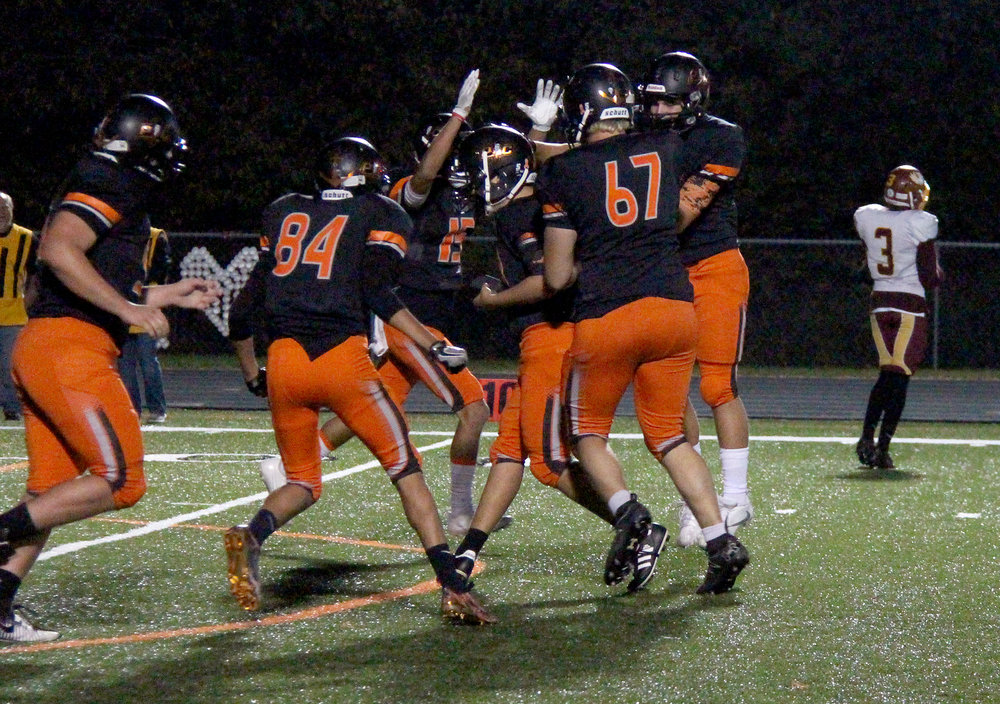 ROSS MARTIN/Citizen photo Platte County players congratulate senior kicker Zach Pixler, center, after he made an extra point in the second half.
