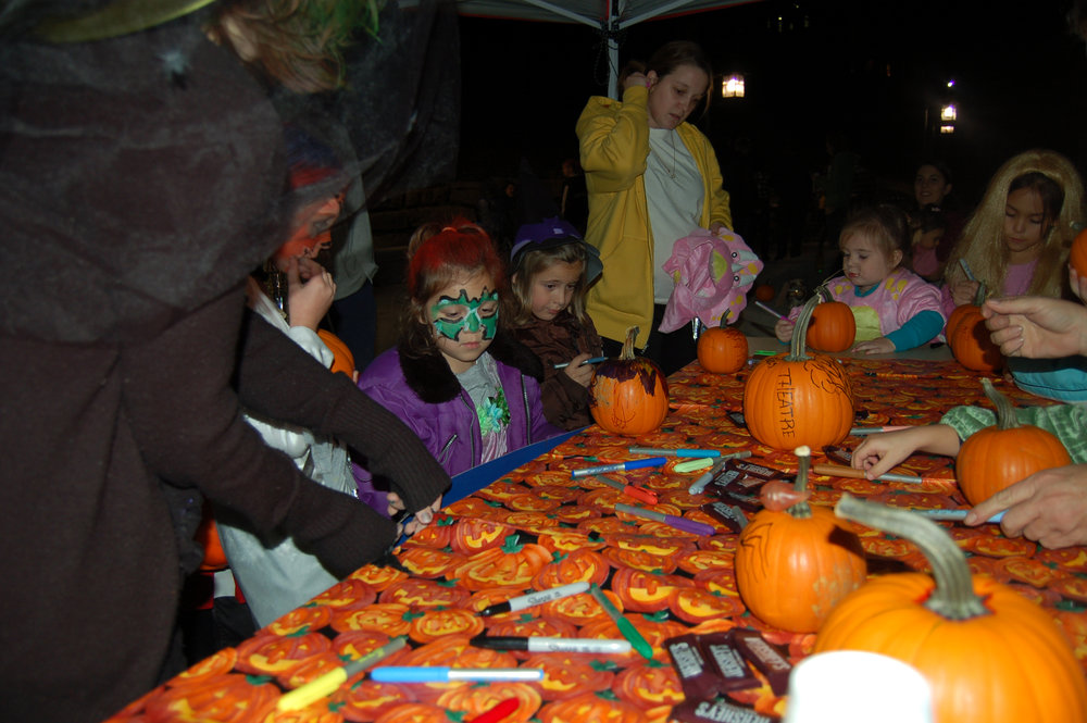 "Contributed photo Children paint pumpkins during a previous ""Fright Night"" at Park University in Parkville, Mo. The annual event features trick-or-treating and activities for children with more than 25 student organizations involved. This year's event will be Thursday, Oct 27 on the Parkville campus."