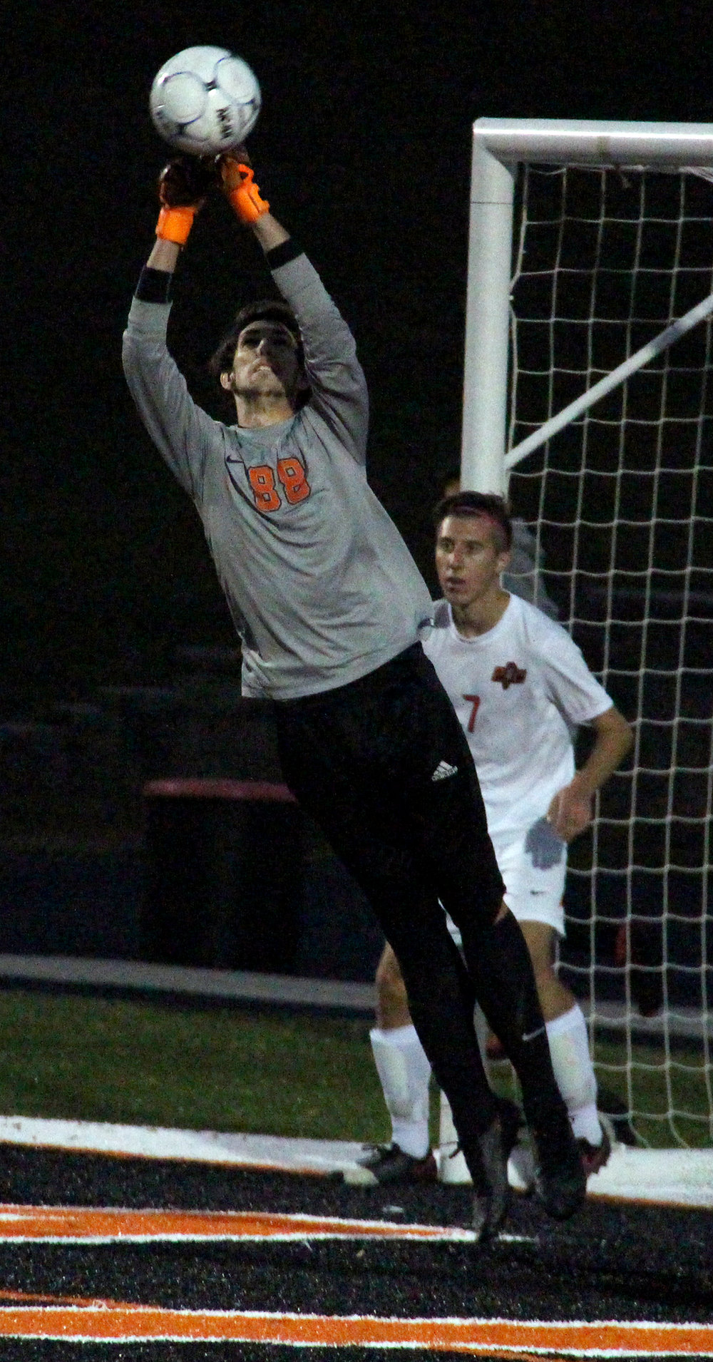 ROSS MARTIN/Citizen photo Platte County senior goalkeeper Bailey Ride (00) punches away a cross during the Class 3 District 16 championship game against Kearney on Wednesday, Oct. 26 at Pirate Stadium.