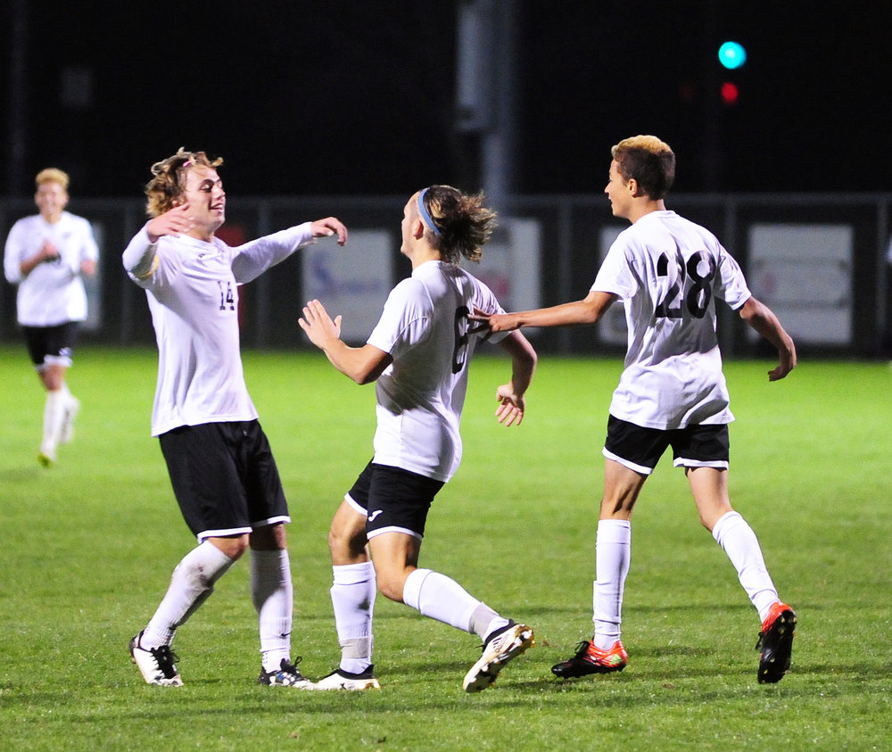 NICK INGRAM/Citizen photo Park Hill South seniors Dan Geary (14) and Ryan DiBernardo (6) celebrate a goal in the Class 4 District 15 championship game Thursday, Oct. 27 at Liberty Middle School in Liberty, Mo.