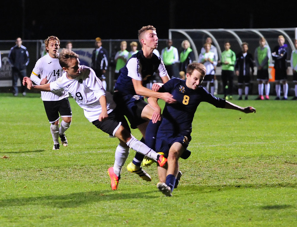 NICK INGRAM/Citizen photo Park Hill South senior Daniel Gunderson (9) takes a shot at the goal before Liberty North senior Quentin Kaiser can block him during the Class 4 District 15 championship on Wednesday, Oct. 26 at Liberty Middle School in Liberty, Mo.