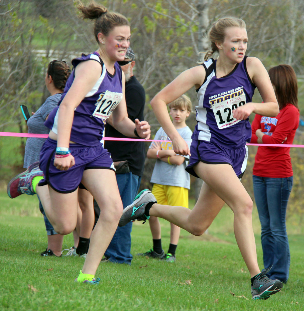 ROSS MARTIN/Citizen photo North Platte teammates Savannah Lingle, left, and Bailee Romaker sprint to the finish of the Class 2 District 8 race Saturday, Oct. 29 at Jesse James Park in Kearney, Mo.