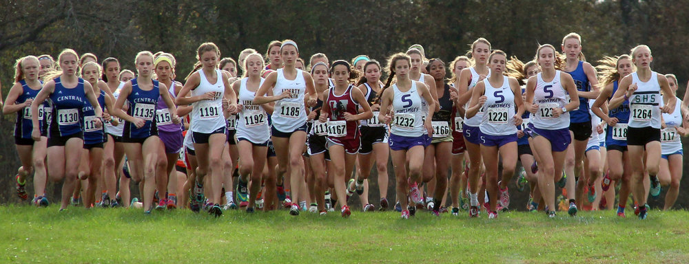 ROSS MARTIN/Citizen photo Park Hill South senior Lexi Maddox (1732), senior Jasmine Crawford (1229) and junior Marti Heit (123) lead the pack at the start of the Class 4 Sectional 4 race Saturday, Oct. 29 at Jesse James Park in Kearney, Mo.
