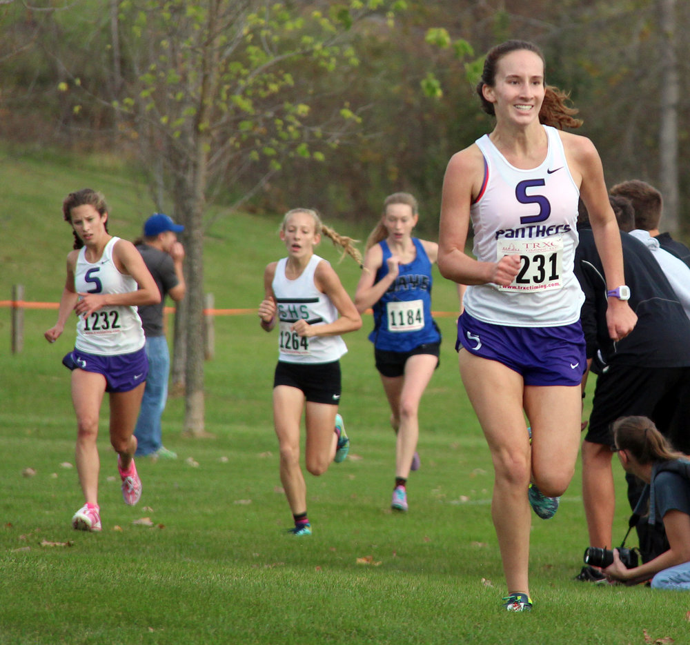 ROSS MARTIN/Citizen photo Park Hill South junior Marti Heit (1231) runs toward the finish line of the Class 4 Sectional 4 race.